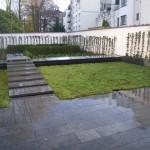 Aménagement de jardin avec pose de dalles en pierre bleue
